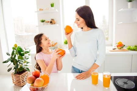 Foto de Beautiful lovely nice charming cheerful mom and her small little - Imagen libre de derechos