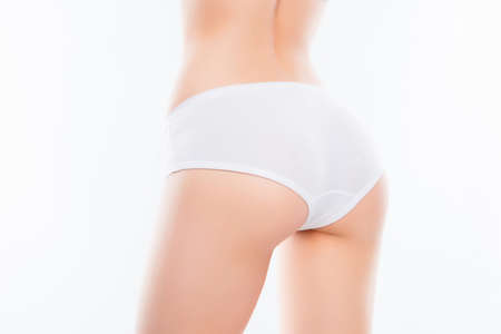 Foto per Close up photo of fit womans ass with perfect ideal skin in white - Immagine Royalty Free