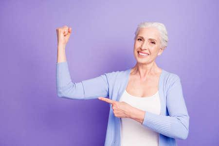 Foto de Strength concept. Beautiful nice cheerful smiling gray-haired ol - Imagen libre de derechos