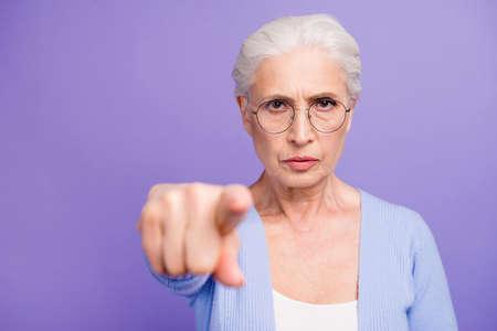 Foto de Portrait of beautiful angry gray-haired old lady wearing casual, - Imagen libre de derechos