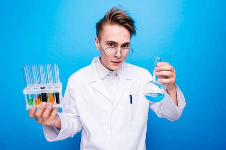 Foto de Portrait of overworked inventor evil genius in formal wear isolated - Imagen libre de derechos