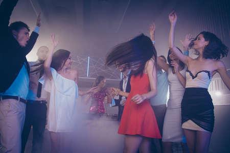 Photo pour Handsome mans and attractive, beautiful ladies dance waving hair - image libre de droit