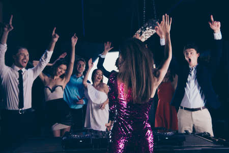 Photo for Nightlife concert concept. Dj stand back to the camera in front - Royalty Free Image
