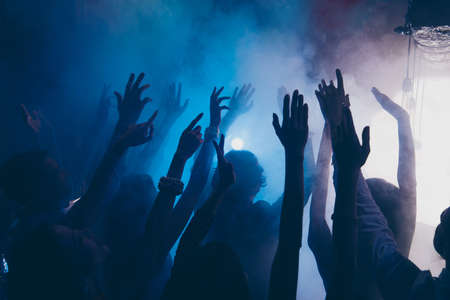 Photo pour Close up cropped photo of people raised hands up in blue whire situation - image libre de droit