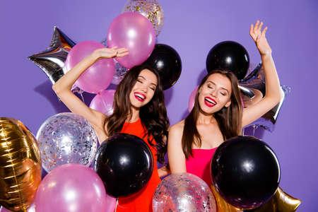 Photo pour Careless, carefree concept. Two dream, dreamy ladies with balloons - image libre de droit