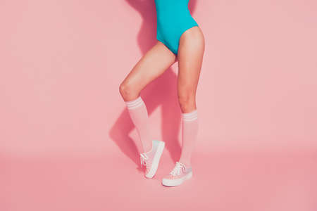 Photo pour Cropped  legs nice slim fit thin sportive magnificent perfect line shape figure girl standing making step posing blue one-piece outfit isolated over pink pastel background - image libre de droit