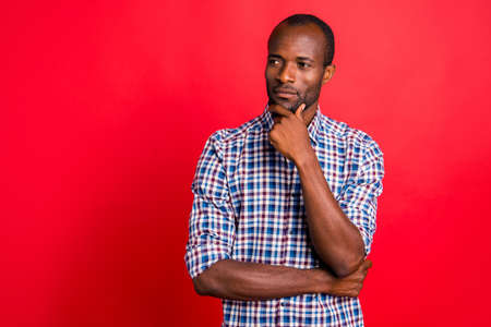 Photo pour Portrait of nice handsome well-groomed attractive calm minded guy wearing checked shirt touching chin isolated over bright vivid shine red background - image libre de droit
