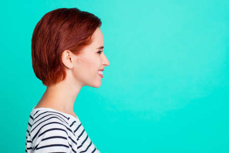 Foto de Profile side view portrait of her she nice charming pretty sweet attractive cheerful cheery red-haired lady wearing striped pullover isolated over bright vivid shine green turquoise background - Imagen libre de derechos