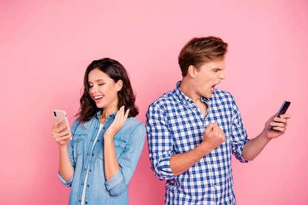 Photo pour Photo of busy couple with telephones - image libre de droit