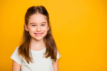 Photo pour Portrait of her she nice-looking cute winsome sweet attractive lovely pretty cheerful cheery positive caucasian pre-teen girl isolated over bright vivid shine yellow background - image libre de droit