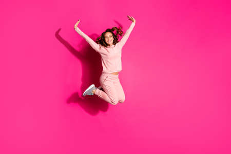Photo pour Full length body size photo eyes closed jump high amazing she her lady hands arms help fly arms up like child wearing casual pink costume suit pullover outfit isolated vibrant rose background - image libre de droit