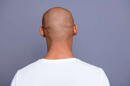 Photo for Close up back behind rear view photo dark skin he him his man turned to empty space distracted unrecognizable groomed shaved head wearing white t-shirt outfit clothes isolated on grey background - Royalty Free Image