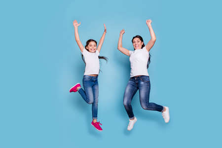 Photo pour Full length body size view of two nice cute lovely winsome attractive adorable cheerful cheery slim people in white t-shirt raising hands up rejoice isolated over blue pastel background - image libre de droit