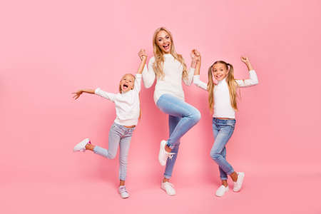 Foto de Full length size body portrait of nice cute attractive charming cheerful cheery kind people mom mum mommy holding hands spending free time isolated over pink pastel background - Imagen libre de derechos
