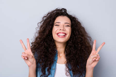 Photo for Close-up portrait of her she nice cute charming winsome attractive lovely cheerful optimistic funny toothy wavy-haired girl showing double v-sign pleasure isolated over gray pastel background - Royalty Free Image