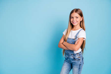 Photo pour Portrait of her she nice-looking cute lovely attractive cheerful cheery straight-haired blonde girl folded arms copy space isolated on blue pastel background - image libre de droit