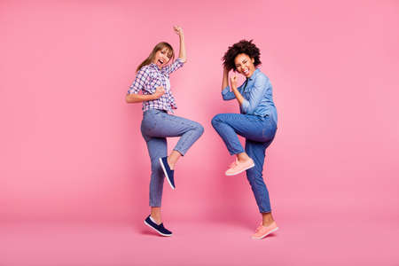 Photo pour Full length body size view of two person nice crazy lovely charming cheerful cheery girls having fun party clubber isolated over pink pastel background - image libre de droit