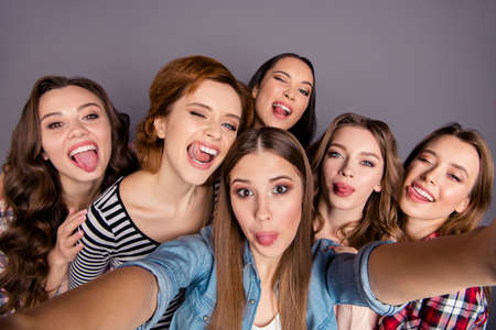 Photo pour Close up top above high angle view photo beautiful she her six ladies roommates make take selfies fooling around wearing casual jeans denim checkered striped clothes outfit isolated grey background - image libre de droit