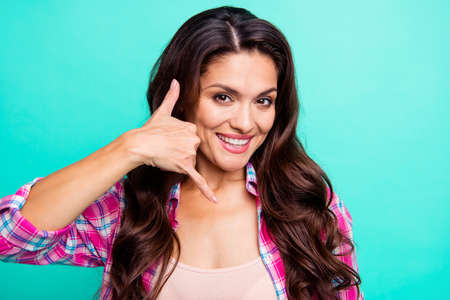 Photo pour Call me now please I am waiting expecting you Close-up portrait of attractive sweet cheery wavy-haired lady wearing checked shirt showing like cell isolated on turquoise bright vivid shine background - image libre de droit