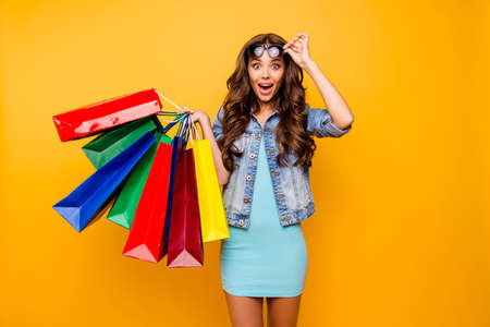 Photo for Close up photo beautiful her she lady yell scream shout new staff shopping spree excited big choice choose wear specs blue teal green short dress jeans denim jacket clothes isolated yellow background - Royalty Free Image