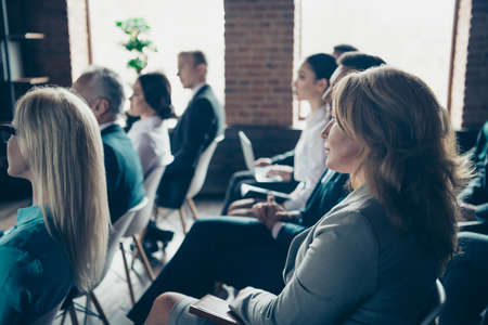 Photo for Profile side view of nice focused crowd elegant classy stylish sharks experts members participants attending educative classes courses lecture at industrial loft style interior work place station - Royalty Free Image