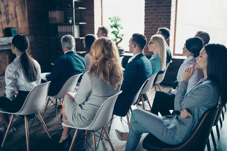 Photo for Profile side view of crowd nice trendy specialists experts sharks attending educative classes courses lecture corporate conference at industrial loft style interior work place station indoors - Royalty Free Image