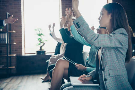 Photo for Profile side view of nice attractive stylish cheerful ladies attending educative forum listening top manager start-up project rising hands up industrial loft interior work place space indoors - Royalty Free Image