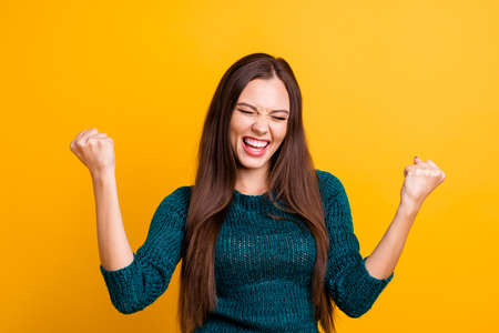Foto de Close up photo beautiful yelling her she lady eyes closed open toothy mouth arms fists raised up air brown eyes ecstatic wear green knitted pullover jumper clothes isolated yellow background - Imagen libre de derechos