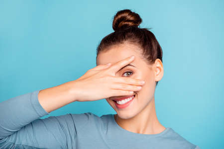 Photo pour Close up photo beautiful she her lady arm hand fingers raised hide half face toothy beaming smile cute nice-looking friendly enjoy day off wear casual sweater pullover isolated blue bright background - image libre de droit