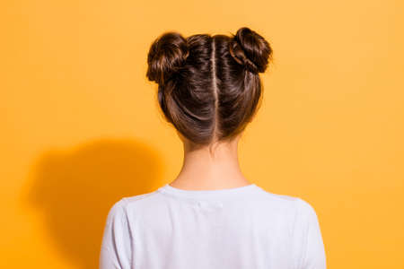 Photo for Back side view close up photo of nice pleasant young woman in white clothing showing her new haircut made by hairdresser isolated over vivid yellow background - Royalty Free Image