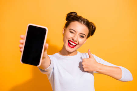 Foto de Close up photo of charming beautiful attractive lady offering suggesting recommending product raising her thumb up dressed up white sweater isolated over vivid background - Imagen libre de derechos