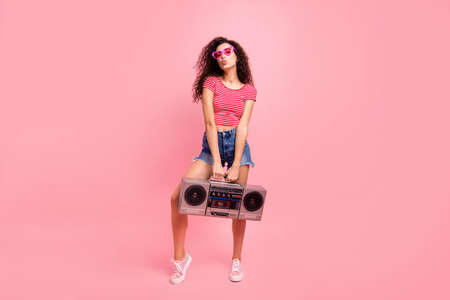 Photo pour Full length body size view portrait of her she nice attractive lovely cool charming cheerful cheery wavy-haired lady carrying player night club clubber isolated over pink pastel background - image libre de droit