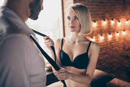 Foto de Portrait of two person nice-looking lovable sweet stunning gorgeous attractive feminine lady teasing businessman successful guy in loft brick industrial style interior room house hotel indoors - Imagen libre de derechos