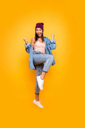 Foto de Full length body size view photo cute pretty attractive youth millennial rejoice satisfied lottery aim celebration luck lucky cap scream shout yeah raise fists isolated yellow background denim costume - Imagen libre de derechos