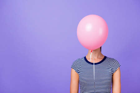 Photo for Close-up portrait of her she nice attractive funny girl closing face with pink helium ball concept isolated over violet purple vivid shine bright background - Royalty Free Image