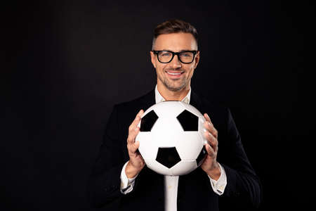 Photo pour Close-up portrait of his he nice-looking attractive content cheerful cheery professional director holding in hands ball career development growth progress isolated over black background - image libre de droit