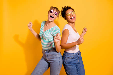 Photo pour Close up photo beautiful funny she her lady party guys hands arms raised up modern motion different nationalities wear sun specs casual white striped t-shirt clothes isolated yellow bright background - image libre de droit