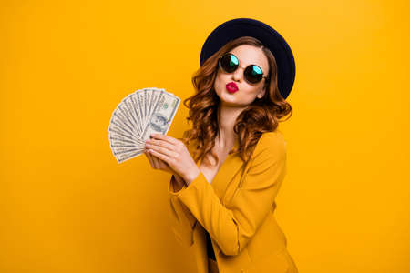 Photo pour Close up photo beautiful she her lady abroad vacation traveler red allure kiss buy present gift fan usa bucks sale discount high social status wear specs formal-wear isolated yellow bright background - image libre de droit
