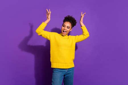 Photo pour Portrait of cute youth raise hands arms scream shout isolated over violet background - image libre de droit