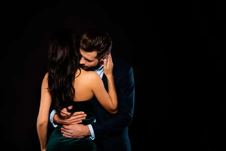 Photo pour Close up back rear behind photo beautiful she her wife spine he him his husband mrs mr married spouse hands waist bend touch hold close wear costume jacket green dress isolated black background - image libre de droit