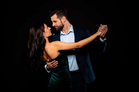 Photo for Close up back rear behind photo beautiful she her wife he him his husband mrs mr married spouse hold hands tango slow dance position gentle wear costume jacket green dress isolated black background - Royalty Free Image