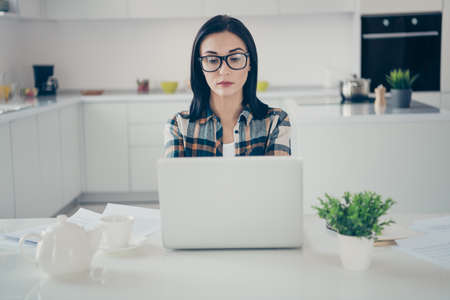 Photo for Portrait of lovely charming focused lady feel pensive use user device start-up blogging wear checkered shirt plaid sit desk tables desktop modern apartment - Royalty Free Image