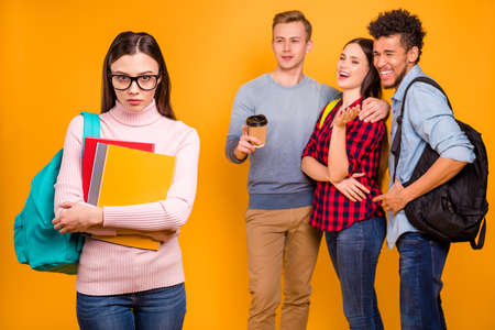 Photo for Portrait of nice-looking attractive lovely cheerful cheery company discussing gossiping about expelled odd unwanted intellectual girl isolated over bright vivid shine yellow background - Royalty Free Image