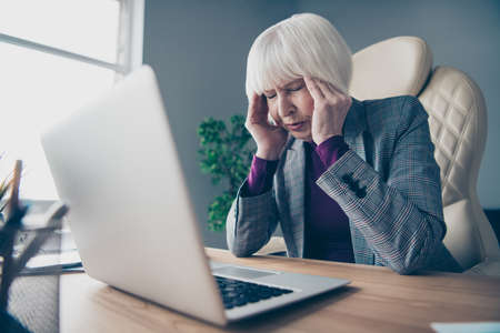 Foto de Close up photo of aged business lady unwell hold hand temples overworked need rest day off sit office chair wear costume suit jacket - Imagen libre de derechos