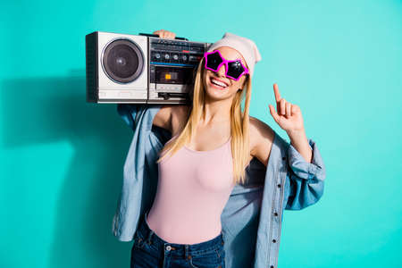 Photo for Portrait of her she nice attractive lovely cute cheerful cheery positive girl wearing cool eyewear carrying stereo mp3 having fun isolated on bright vivid shine blue green turquoise background - Royalty Free Image