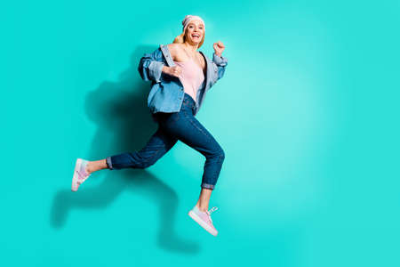 Foto de Full length body size profile side view of her she nice attractive lovely cheerful cheery glad girl having fun spring marathon isolated over bright vivid shine blue green turquoise background - Imagen libre de derechos