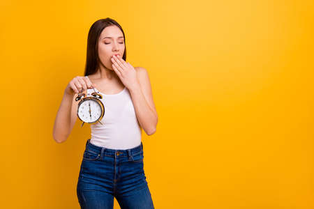 Photo pour Portrait of disappointed work worker have job missed deadline want sleep dressed she denim top white isolated colorful yellow background - image libre de droit
