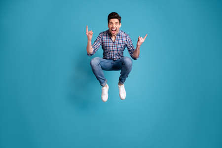 Foto de Full length body size view photo charming rejoice positive cheerful youth free time holidays shout dream dreamy playful wear fashionable plaid jeans clothes legs sneakers isolated blue background - Imagen libre de derechos