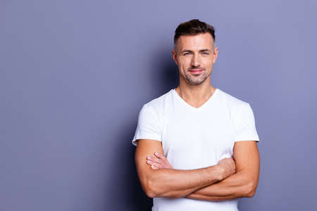 Foto de Close up photo amazing he him his middle age macho chief boss perfect ideal appearance easy-going reliable person look calm show white teeth bristle wear casual white t-shirt isolated grey background - Imagen libre de derechos