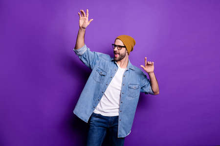 Photo pour Portrait of his he nice attractive content cool cheerful cheery carefree bearded guy celebrating great festal party having fun isolated over bright vivid shine violet lilac background - image libre de droit